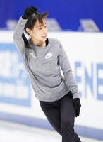 Figure skater Mai Mihara is seen at an official practice session for the national championships at the Big Hat arena in Nagano, central Japan, on Dec. 24, 2020. (Pool photo)