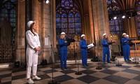 In this photo provided by Maitrise Notre-Dame de Paris soprani singer Julie Fuchs and the Notre Dame Cathedral choir record a Christmas concert on Dec. 19, 2020, inside Notre Dame Cathedral in Paris. (MSNDP/Musique Sacree a Notre-Dame de Paris via AP)
