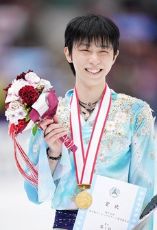 Gold medalist Yuzuru Hanyu is seen smiling during the medal ceremony for the Japan Figure Skating Championships at the Big Hat arena in the city of Nagano, central Japan, on Dec. 26, 2020. (Pool photo)