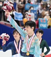 Gold medalist Yuzuru Hanyu, center, silver medalist Shoma Uno, left, and bronze medalist Yuma Kagiyama, right, are seen waving at fans following the men's single free skating competition at the Japan Figure Skating Championships at the Big Hat arena in the city of Nagano, central Japan, on Dec. 26, 2020. (Pool photo)
