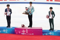 Gold medalist Yuzuru Hanyu, center, silver medalist Shoma Uno, left, and bronze medalist Yuma Kagiyama, right, are seen during the medal ceremony for the Japan Figure Skating Championships at the Big Hat arena in the city of Nagano, central Japan, on Dec. 26, 2020. (Pool photo)