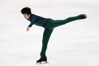 Yuma Kagiyama performs in the men's single free skating competition at the Japan Figure Skating Championships at the Big Hat arena in the city of Nagano, central Japan, on Dec. 26, 2020. (Pool photo)