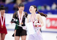 Gold medalist Rika Kihira is seen smiling during the award ceremony for the Japan Figure Skating Championships at the Big Hat arena in the city of Nagano, central Japan, on Dec. 27, 2020. (Pool photo)
