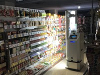 A robot is seen patrolling the shelves at night after closing time at the Kasumi Food Square Olinus Kinshicho supermarket in Sumida Ward, Tokyo, in this image provided by Kasumi Co.