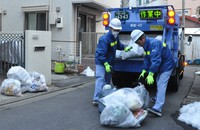 Sanitation workers collect garbage in a residential area. It is predicted that the collection of