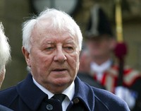 In this Feb. 27, 2014 file photo, former Manchester United manager and Preston North End player Tommy Docherty is seen before a funeral service for the late Sir Tom Finney at Preston Minster, Preston, England. (AP Photo/Jon Super)