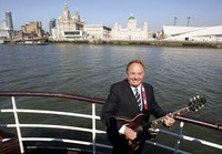This April 20, 2009 file photo shows Gerry Marsden on board the Mersey ferry. (Dave Thompson/PA via AP)