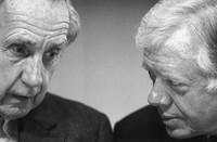 In this Nov. 17, 1987 file photo, Sir Brian Urquhart, former under secretary-general of the United Nations, left, and former President Jimmy Carter confer during the opening session of a Middle East conference held at the Carter Center in Atlanta, Ga. (AP Photo/Linda Schaefer)