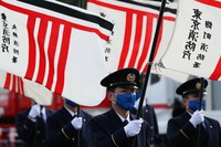 Firefighters hold their fire stations' flags during the Tokyo Fire Department's New Year drills in the capital's Koto Ward on Jan. 6, 2021. (Mainichi/Kota Yoshida)