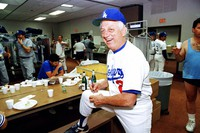 Los Angeles Dodgers manager Tommy Lasorda autographs a baseball in the Dodgertown locker-room in Vero Beach, Fla., in this Feb. 15, 1990, file photo. (AP Photo/Richard Drew)