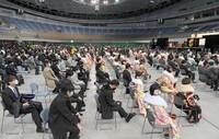 A coming-of-age ceremony is held in the Fukuoka Prefecture city of Kitakyushu on Jan. 10, 2021, while each seat is spaced out to maintain distance between participants. (Mainichi/Toyokazu Tsumura)