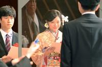 Miharu Tanaka, center, representing those celebrating their coming-of-age in the city of Kagoshima, makes a speech in front of Kagoshima Mayor Takao Shimozuru, with an acrylic screen separating the two, on Jan. 10, 2021. (Mainichi/Takaharu Nishi)