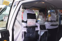 A taxi with a plastic sheet that separates the front and back seats is seen in this file photo. (Mainichi/Ami Jinnai)