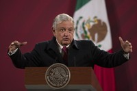In this Dec. 18, 2020 file photo, Mexican President Andres Manuel Lopez Obrador gives his daily, morning news conference at the presidential palace, Palacio Nacional, in Mexico City. (AP Photo/Marco Ugarte)
