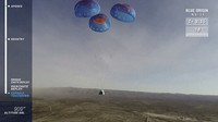 In this image from video made available by Blue Origin, the company's RSS First Step capsule uses parachutes for landing after a test flight in West Texas on Jan. 14, 2021. (Blue Origin via AP)