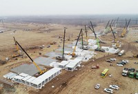 In this aerial photo released by China's Xinhua News Agency, workers build a large centralized quarantine facility in Shijiazhuang in northern China's Hebei Province, on Jan. 14, 2021. (Yang Shiyao/Xinhua via AP)