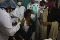 A hospital staff receives a COVID-19 vaccine at a government hospital in Hyderabad, India, on Jan. 16, 2021. (AP Photo/Mahesh Kumar A.)