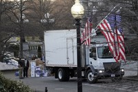 A van arrives to pick up boxes that were moved out of the Eisenhower Executive Office building, inside the White House complex in Washington, on Jan. 14, 2021. (AP Photo/Gerald Herbert)
