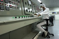 In this Feb. 3, 2007 file photo, a technician works at the Uranium Conversion Facility just outside the city of Isfahan, Iran, 255 miles (410 kilometers) south of the capital Tehran. (AP Photo/Vahid Salemi, File)