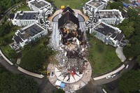 A government building is seen badly damaged following an earthquake in this aerial photo taken using a drone in Mamuju, West Sulawesi, Indonesia, Saturday, Jan. 16, 2021. (AP Photo/Abdi Latief)