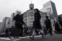 People wearing protective masks to help curb the spread of the coronavirus walk in the Ginza shipping area of Tokyo on Jan. 15, 2021. (AP Photo/Eugene Hoshiko)