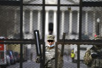 Members of the National Guard stand inside the security fencing at the Capitol ahead of the inauguration of President-elect Joe Biden and Vice President-elect Kamala Harris, on Jan. 17, 2021 in Washington. (AP Photo/John Minchillo)