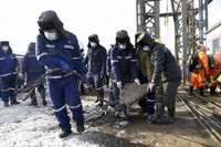 In this photo released by China's Xinhua News Agency, rescuers work at the site of a gold mine that suffered an explosion in Qixia in eastern China's Shandong Province, on Jan. 12, 2021. (Wang Kai/Xinhua via AP)