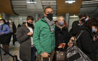 Alexei Navalny and his wife Yulia stand in line at passport control after arriving at Sheremetyevo airport, outside Moscow, Russia, on Jan. 17, 2021. (AP Photo/Mstyslav Chernov)