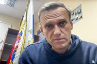 In this image taken from video released by Navalny Life youtube channel, Russian opposition leader Alexei Navalny speaks as he waits for a court hearing in a police station in Khimki, outside in Moscow, Russia, on Jan. 18, 2021. (Navalny Life youtube channel via AP)