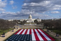 A large American Flag is seen placed on the National Mall, with the U.S. Capitol behind, ahead of the inauguration of President-elect Joe Biden and Vice President-elect Kamala Harris, on Jan. 18, 2021, in Washington. (AP Photo/Alex Brandon)