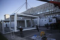 Workers set up new modules to expand the capacity of the COVID-19 emergency ward at the Santa Maria hospital in Lisbon, on Jan. 18, 2021. (AP Photo/Armando Franca)