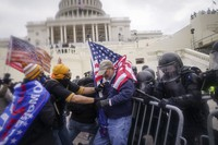 In this Jan. 6, 2021 photo, rioters try to break through a police barrier at the Capitol in Washington. (AP Photo/John Minchillo)