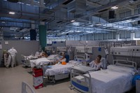 COVID-19 patients receive treatment at the new Nurse Isabel Zendal Hospital in Madrid, Spain, on Jan. 18, 2021. (AP Photo/Bernat Armangue)