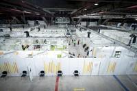 People stay in the new open Erika-Hess-Eisstadion vaccine center in Berlin, Germany, on Jan. 14, 2021. (Kay Nietfeld/Pool via AP)