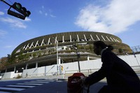 The Japan National Stadium, where the opening ceremony and many other events are planned for the postponed Tokyo 2020 Olympics, is seen in Tokyo on Jan. 18, 2021. (AP Photo/Eugene Hoshiko)
