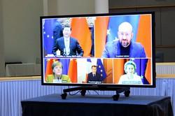 中国の習近平国家主席(画面左上)は米新政権発足前にEUと手を結びたかった?(Bloomberg)
