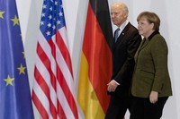 This Feb. 1, 2013 file photo shows German Chancellor Angela Merkel, right, and then-U.S. Vice President Joe Biden at the chancellery in Berlin, Germany. (AP Photo/Markus Schreiber)