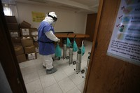 City worker Carlos Ruiz prepares tanks of oxygen for COVID-19 patients, in the Iztapalapa borough of Mexico City, on Jan. 15, 2021. (AP Photo/Marco Ugarte)