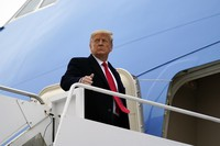 In this Jan. 12, 2021 file photo, U.S. President Donald Trump gestures as he boards Air Force One upon arrival at Valley International Airport, in Harlingen, Texas. (AP Photo/Alex Brandon)