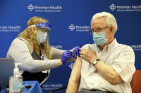 Don Pelfrey receives a dose of the COVID-19 vaccine from licensed practical nurse Tami Arnold Tuesday on Jan. 19, 2021, at Atrium Medical Center in Middletown, Ohio. (Kareem Elgazzar /The Cincinnati Enquirer via AP)