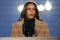 Vice President-elect Kamala Harris speaks during a COVID-19 memorial, with lights placed around the Lincoln Memorial Reflecting Pool, Tuesday, Jan. 19, 2021, in Washington. (AP Photo/Alex Brandon)