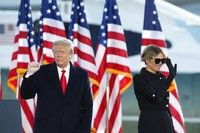 President Donald Trump and first lady Melania Trump wave to supporters after giving a speech at Andrews Air Force Base, Md., on Jan. 20, 2021. (AP Photo/Luis M. Alvarez)
