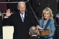 Joe Biden is sworn in as the 46th president of the United States by Chief Justice John Roberts as Jill Biden holds the Bible during the 59th Presidential Inauguration at the U.S. Capitol in Washington, on Jan. 20, 2021.(Saul Loeb/Pool Photo via AP)