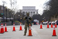 A National Guard stands at a road block near the Supreme Court ahead of President-elect Joe Biden's inauguration ceremony, on Jan. 20, 2021, in Washington. (AP Photo/Gerald Herbert)