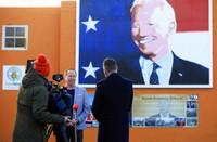 Joe Biden's cousin Joe Blewitt speaks to the media underneath his mural painted on a wall in Ballina, Ireland, on Jan. 20, 2021. (AP Photo/Peter Morrison)