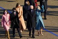 President Joe Biden and his wife Jill Biden walk in a parade during the Presidential Escort, part of Inauguration Day ceremonies, on Jan. 20, 2021, in Washington. (AP Photo/David J. Phillip)