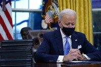 President Joe Biden pauses as he signs his first executive orders in the Oval Office of the White House on Jan. 20, 2021, in Washington. (AP Photo/Evan Vucci)