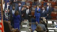 In this image from video, Vice President Kamala Harris swears in Sen. Raphael Warnock, D-Ga., Sen. Alex Padilla, D-Calif., and Sen. Jon Ossoff, D-Ga., on the floor of the Senate on Jan. 6, 2021, on Capitol Hill in Washington. (Senate Television via AP)