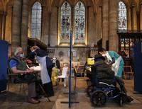 People receive their Pfizer-BioNTech vaccination inside Salisbury Cathedral in Salisbury, U.K., on Jan. 20, 2021. (AP Photo/Frank Augstein)