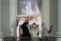 U.S. President Joe Biden and first lady Jill Biden watch fireworks from the White House on Jan. 20, 2021, in Washington. (AP Photo/Evan Vucci)